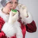 Mrs Claus eating a cookie